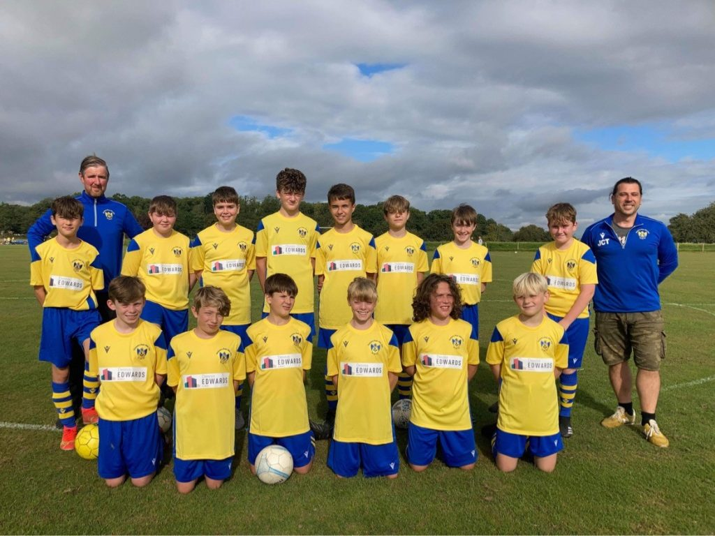Oswestry Boys Club under-13 squad in their new kit sponsored by Dennis Edwards Homes